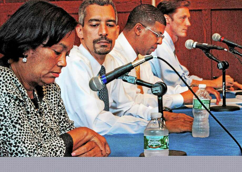 (Melanie Stengel — New Haven Register ) Left to Right: Mayoral candidates, Toni Harp, Henry Fernandez, Kermit Carolina, and JustinElicker, take a few final moments to prepare for their debate at the Afro American Cultural Center at Yale 9/4. Photo: Journal Register Co.