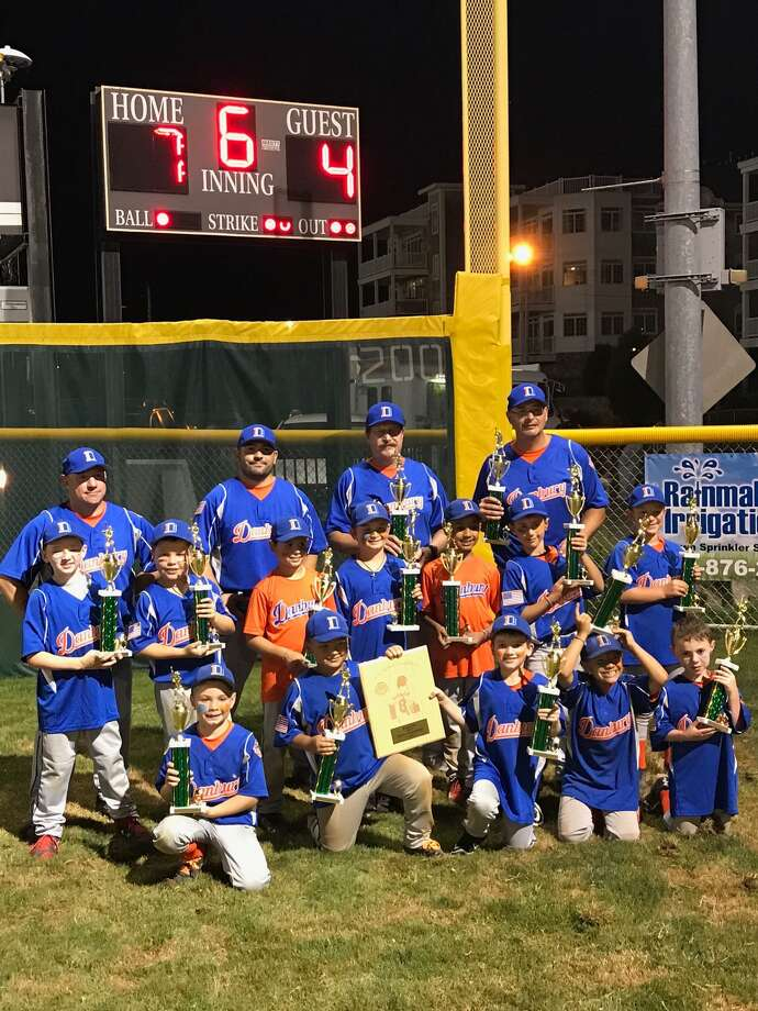 The Danbury 8U tournament baseball team beat West Haven 7-4 on Sunday to win the state championship. The team advances to the regionals on Friday in Chelmsford, Mass. Team members include, front, from left, Bobby Mariano, Izaiah Scalzo, Jimmy Bianco, Lawrence Roccamo and Jack Eriquez; middle row, Andrew Devery, Jack Ruffles, Jake O'Keefe, Tyler DiElsi, Julian Diaz, Shawn Torpey and Thomas Giansiracus; back row, coaches, Angelo Mariano, Larry Roccamo, Rick Scalzo and Shawn Torpey. Photo: Contributed Photo