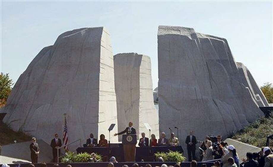 In this 2011, file photo, President Barack Obama speaks at the dedication of the Martin Luther King Jr. Memorial in Washington. Monday's inaugural may be Obama's big day, but Martin Luther King Jr. will loom large over the festivities. A quirk in the calendar pushed Obama's public swearing-in onto the national holiday honoring the slain civil rights leader, and inaugural planners have taken pains to acknowledge that fact. Going into his second term, Obama seems to have put King at the front of his mind, too.  AP Photo/Charles Dharapak Photo: AP / AP