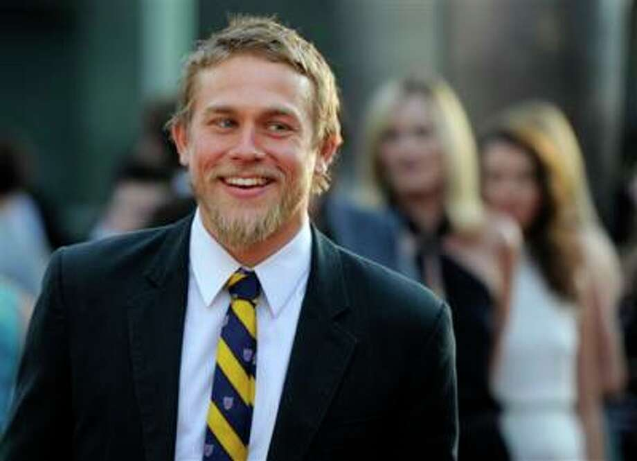 "FILE - In a Tuesday, Aug. 30, 2011 file photo, Charlie Hunnam, a cast member in ""Sons of Anarchy,"" arrives at a screening of the fourth season premiere of the television series, in Los Angeles. Focus Features and Universal Pictures announced Monday, Sept. 2, 2013 that Hunnam will play the 27-year-old billionaire Christian Grey in the big-screen adaptation of E L James? ?Fifty Shades of Grey?. Dakota Johnson will play the college student he captivates, Anastasia Steele. (AP Photo/Chris Pizzello, File) Photo: AP / AP"