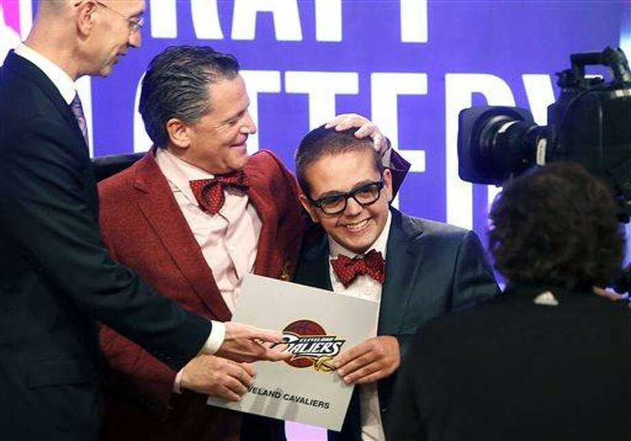 Cleveland Cavaliers owner Dan Gilbert congratulates his son Nick Gilbert after the team won the NBA basketball draft lottery, Tuesday, May 21, 2013 in New York. (AP Photo/Jason DeCrow) Photo: AP / FR103966 AP