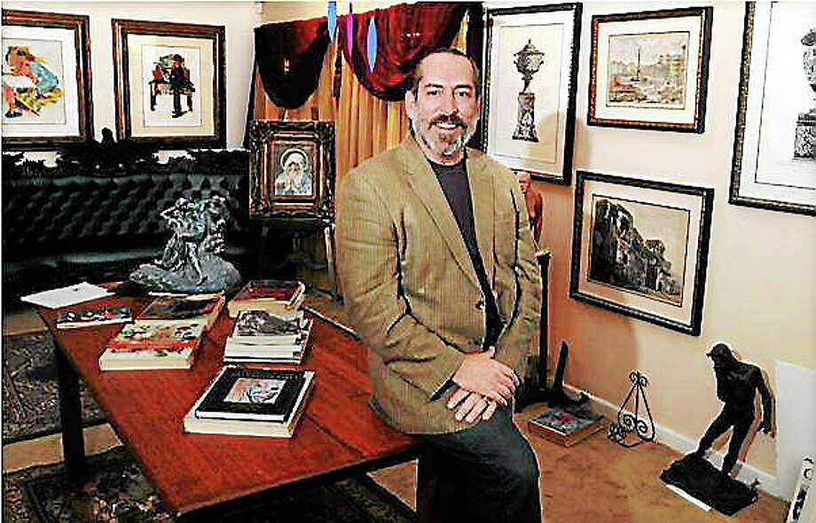 In this 2010 file photo, David Crespo, owner of the Brandon Gallery in Madison, stands in front of some of the art he sells. Photo: (Mara Lavitt/New Haven Register)
