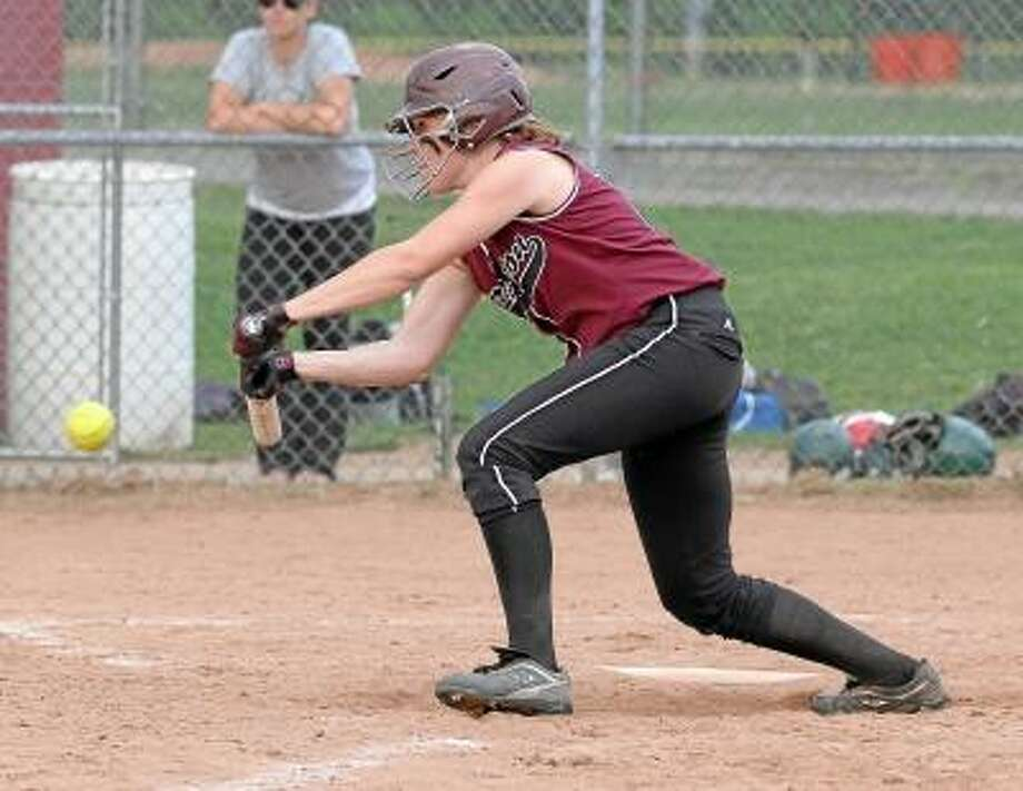Photo by Marianne Killackey/Special to Register Citizen Torrington's Sara Heath bunts for a single in the Raiders' 5-1 victory against Holy Cross. / 2013