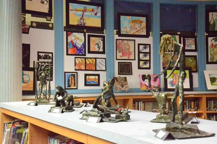 Nick Will/Oneida Daily Dispatch Studio Art 2 students have statues they have made on display in the library of Otto Shortell Middle School for the Art Show opening today.
