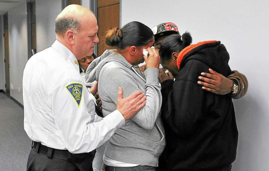 New Haven Police Chief Dean Esserman comforts the family of slaying victim Brian Gibson after a press conference announcing the arrest of Jahmal Fulcher. Photo: Peter Casolino — New Haven Register