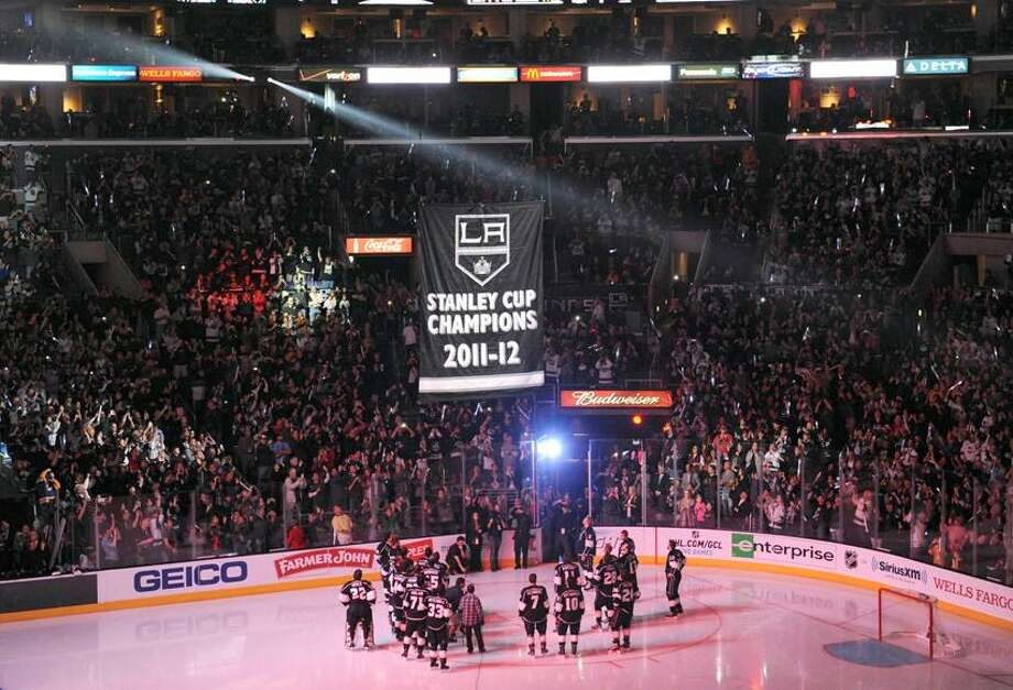 Jan.19, 2012; Los Angeles, CA, USA;   The Stanley Cup championship banner for the Los Angeles Kings is raised during pre-game ceremonies before the game against the Chicago Blackhawks at the Staples Center.  (Jayne Kamin-Oncea-USA TODAY Sports) Photo: Jayne Kamin-Oncea-USA TODAY Spor / Jayne Kamin-Oncea