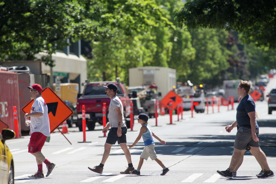Pedestrians walk across 2nd Ave near construction that shuts down part of the road, Tuesday, July 25, 2017. Photo: GRANT HINDSLEY, SEATTLEPI.COM / SEATTLEPI.COM
