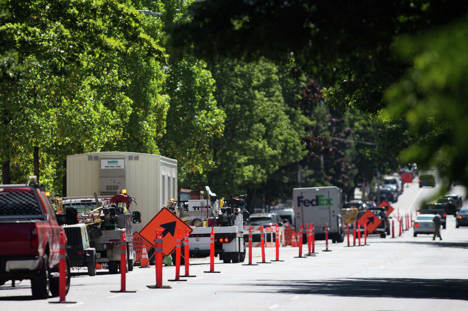 Construction blocks two lanes of traffic on 2nd Ave, Tuesday, July 25, 2017. Photo: GRANT HINDSLEY, SEATTLEPI.COM / SEATTLEPI.COM