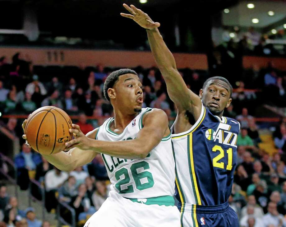 Boston Celtics guard Phil Pressey (26) looks to pass against Utah Jazz guard Ian Clark (21) during the second half of an NBA game in Boston on Wednesday, The Celtics won 97-87. Photo: Elise Amendola  — The Associated Press   / AP