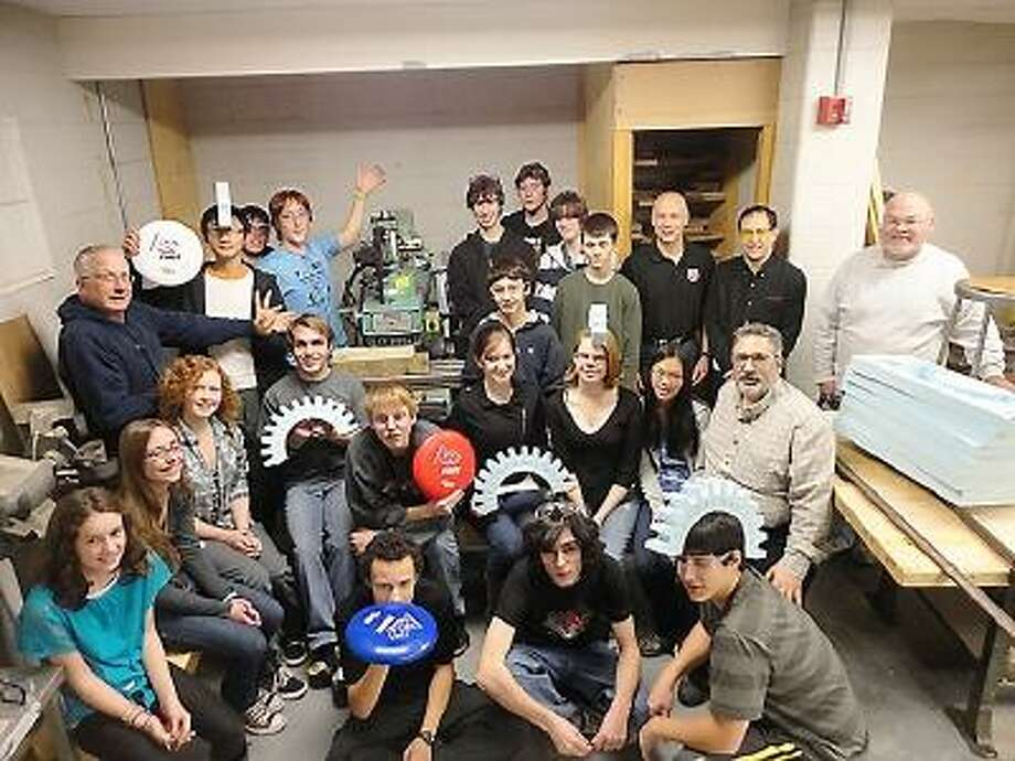 Submitted photo. The Gearheads robotic team with the milling machine donated by the Wittmann-Battenfeld Corporation of Torrington.