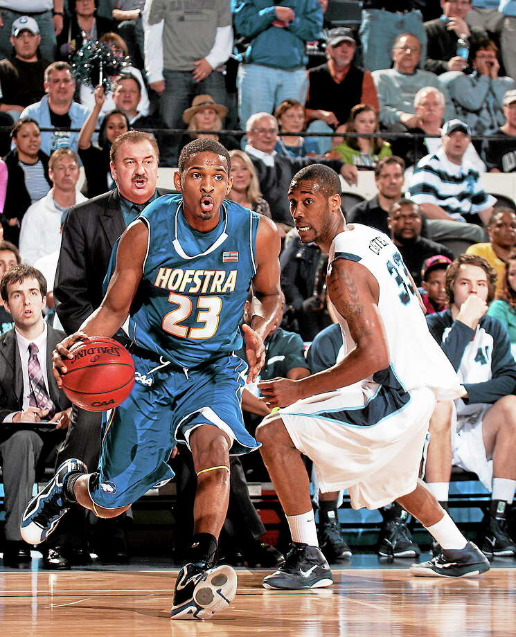 Hillhouse grad Mike Moore (23) of Hofstra drives past Old Dominion's Keyon Carter during a Colonial Athletic Association tournament game in Richmond, Va., on March 6, 2011. Photo: Scott K. Brown — The Associated Press   / AP2011