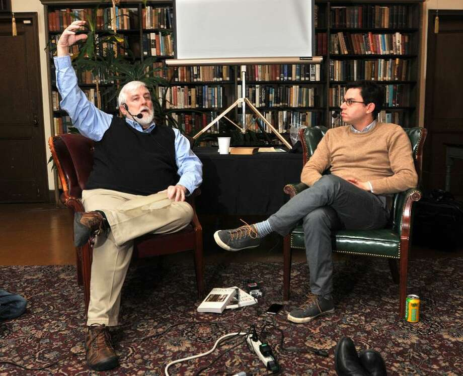 New Haven-- Cryptozoologist Loren Coleman, left, speaks with host Joshua Foer during a talk about legendary creatures such as the Abominable Snowman and Bigfoot at the Institute Library in New Haven. Photo-Peter Casolino 1/15/13