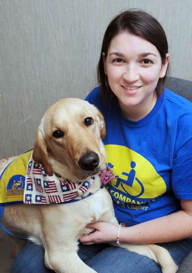 Danielle Drazen is photographed with Sandy, an assistance dog in training for Canine Companions for Independence, in Milford on 1/16/2013.  The two will participate in the 2013 Presidential Inauguration Parade in Washington, D.C. on 1/21/2013.Photo by Arnold Gold/New Haven Register