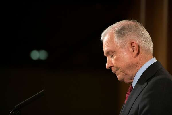 FILE-- Attorney General Jeff Sessions gives a statement stating that he will continue to serve �as long as that is appropriate,� following comments from President Donald Trump, at the Department of Justice in Washington, July 20, 2017. Trump turned up the pressure further on Sessions on July 24, calling him �beleaguered� in a tweet questioning why the Justice Department is not investigating Hillary Clinton. Trump�s comments are remarkable because if Sessions is beleaguered of late it is largely because of Trump himself. (Tom Brenner/The New York Times)