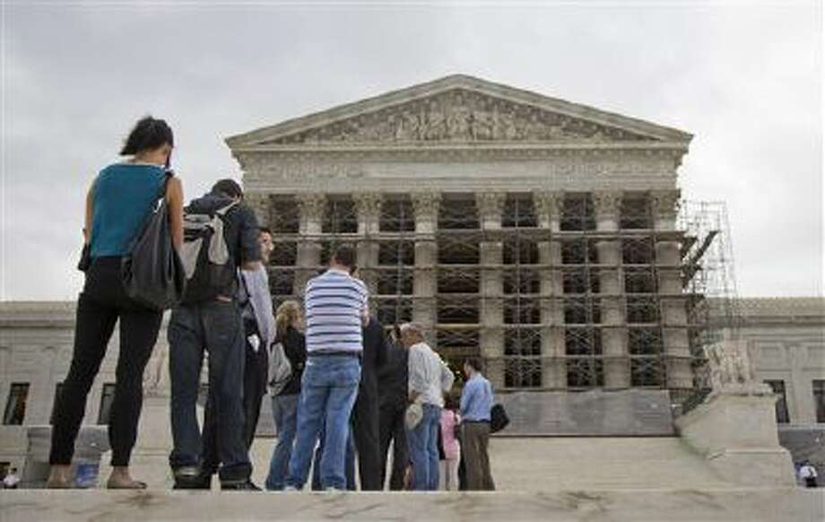 People wait in line to enter the Supreme Court in Washington. Photo: ASSOCIATED PRESS / AP2013