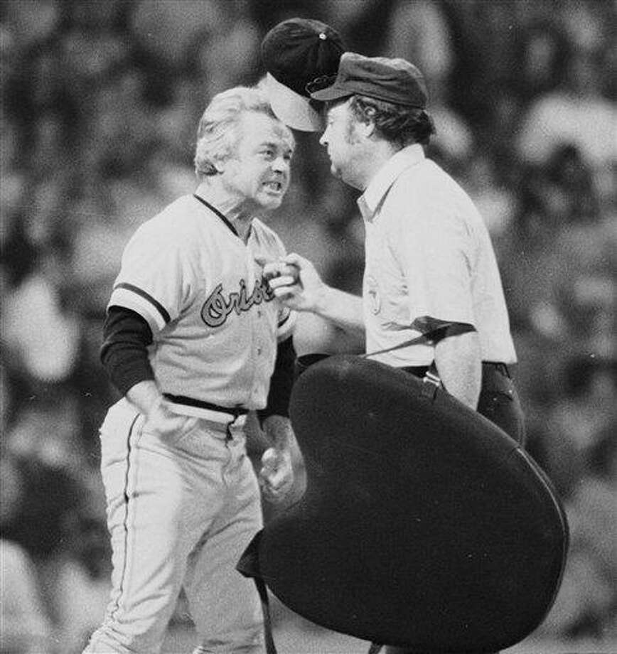 """FILE - In this July 13, 1974 file photo, Baltimore Orioles manager Earl Weaver literally """"flips his lid"""" as he protests a call by home plate umpire Marty Springstead during a baseball game against the Chicago White Sox in Chicago. Weaver, the fiery Hall of Fame manager who won 1,480 games with the Baltimore Orioles, has died, the team announced Saturday, Jan. 19, 2013. He was 82. (AP Photo/File) Photo: ASSOCIATED PRESS / A1974"""