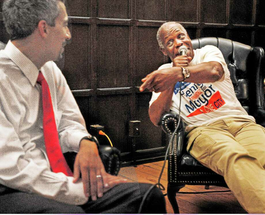 (Melanie Stengel — New Haven Register )  Actor, and activist, Danny Glover (R), talks about why he has come to New Haven to support mayoral candidate, Henry Fernandez 9/2.  Glover was speaking at the Afro American Cultural Center at Yale 9/2. Photo: Journal Register Co.