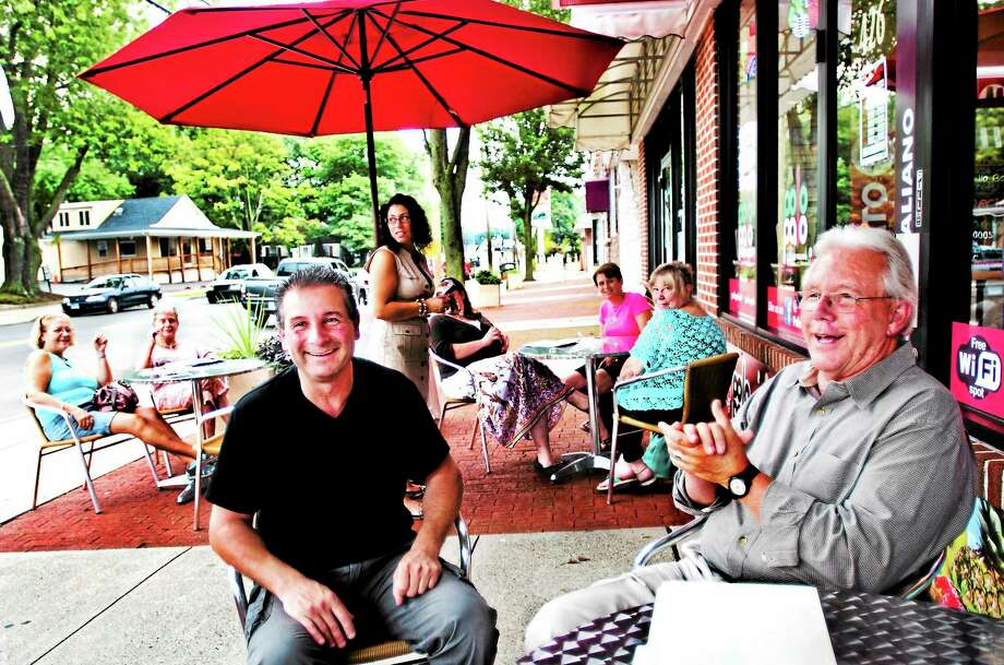 (Melanie Stengel — New Haven Register ) East Haven Mayoral candidate, Jack Stacey (R) talks about his plans for the city. Stacy spoke at Polo Palo Gelato on Main Street. At left iis owner Tony Franco 9/2. Photo: Journal Register Co.