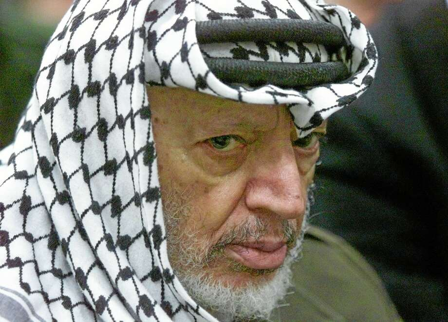 FILE - In this May 31, 2002 file photo, Palestinian leader Yasser Arafat pauses during the weekly Muslim Friday prayers in his headquarters in the West Bank city of Ramallah. Al-Jazeera is reporting that a team of Swiss scientists has found moderate evidence that longtime Palestinian leader Arafat died of poisoning. The Arab satellite channel published a copy of what it said was the scientists' report on its website on Wednesday, Nov. 6, 2013.(AP Photo/Lefteris Pitarakis, File) Photo: AP / AP