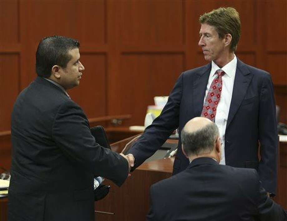 George Zimmerman, left, shakes hands with his defense attorney Mark O'Mara during a recess in his trial in Seminole circuit court in Sanford, Fla. Wednesday, July 10, 2013. Zimmerman has been charged with second-degree murder for the 2012 shooting death of Trayvon Martin. (AP Photo/Orlando Sentinel, Gary W. Green, Pool) Photo: AP / Pool Orlando Sentinel