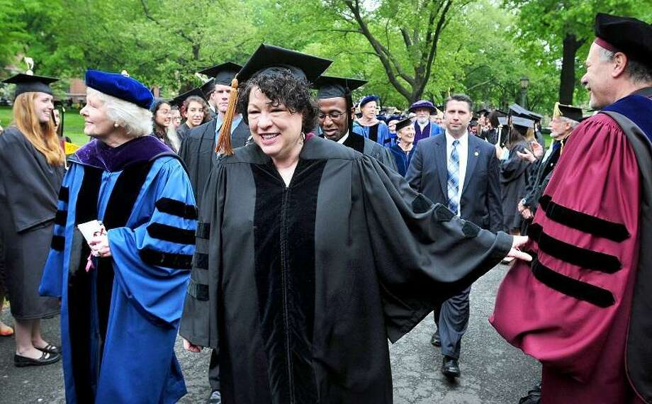 Supreme Court Justice Sonia Sotomayor (center) walks in a procession through the upper New Haven Green to begin the 312th Yale University Commencement in New Haven on 5/20/2013.  At left is Margaret Marshall, Yale Corporation Fellow and former Chief Justice of the Massachusetts Supreme Judicial Court.Photo by Arnold Gold/New Haven Register