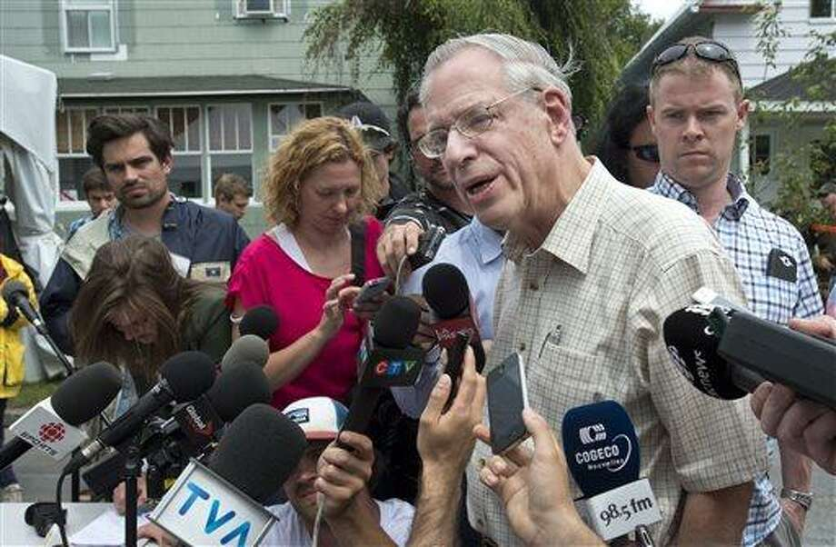 Rail World Inc. president Edward Burkhardt speaks to the media as he tours Lac-Megantic, Quebec, on Wednesday, July 10, 2013.  A  Rail World train crashed into the town killing at least 15 people.  Burkhardt blamed the accident on an employee who he said had failed to properly set the brakes.  (AP Photo/The Canadian Press, Paul Chiasson) Photo: AP / CP