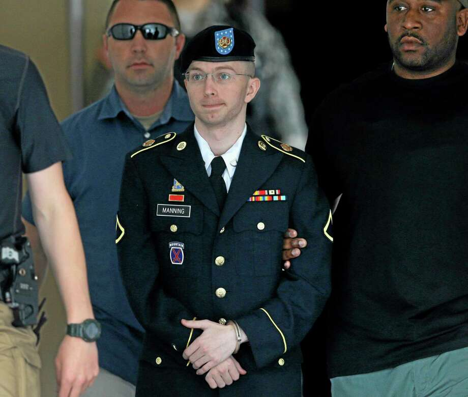 FILE - Army Pfc. Bradley Manning is escorted out of a courthouse in Fort Meade, Md., in a Tuesday, July 30, 2013 file photo, after receiving a verdict in his court martial. Manning's defense team is opening its case at the soldier's sentencing hearing. . (AP Photo/Patrick Semansky, File) Photo: AP / AP