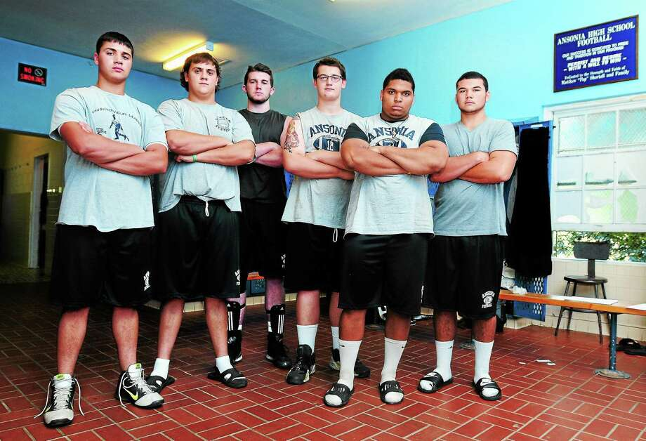 From left, Ansonia offensive linemen Larry Cafaro, Matt Simon, Ryan Hovan, Corey Dzienkiewicz, Antone Mack and Tyler O'Connell have the ability to dominate in the trenches. Photo: Arnold Gold — Register