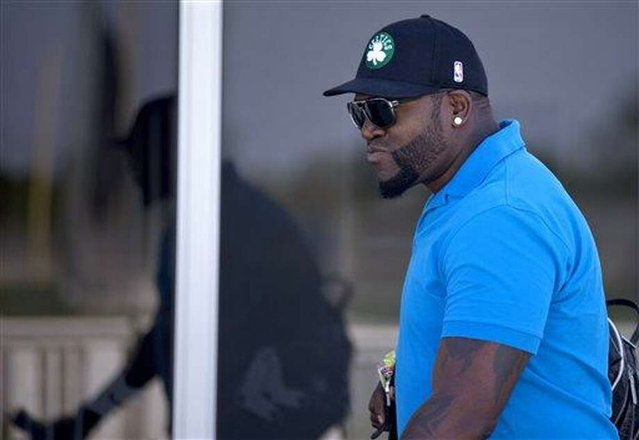 Boston Red Sox's David Ortiz leaves the clubhouse after meeting with trainers at spring training baseball, Sunday, March 10, 2013, in Fort Myers, Fla. (AP Photo/David Goldman) Photo: AP / AP