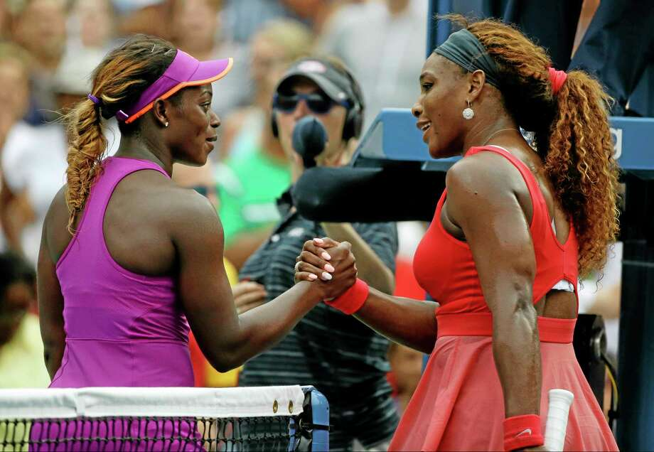 Sloane Stephens congratulates Serena Williams after Williams won their fourth-round match at the U.S. Open on Sunday. Photo: David Goldman — The Associated Press   / AP