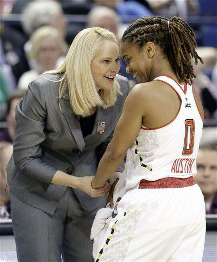 Maryland head coach Brenda Frese, left, talks with Sequoia Austin, right, during the first half of an NCAA college basketball game against North Carolina at the Atlantic Coast Conference tournament in Greensboro, N.C., Saturday, March 9, 2013. (AP Photo/Chuck Burton) Photo: AP / AP