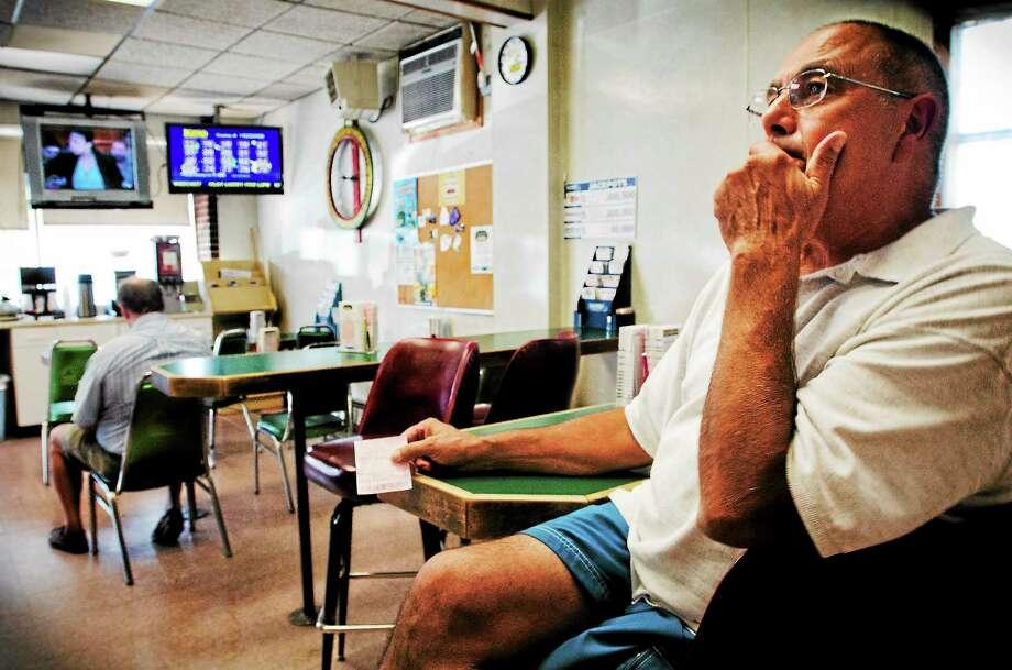 (Melanie Stengel — New Haven Register)   Joe Barbarato plays Keno daily in the Dairy Store in Agawam 8/27. Photo: Journal Register Co.