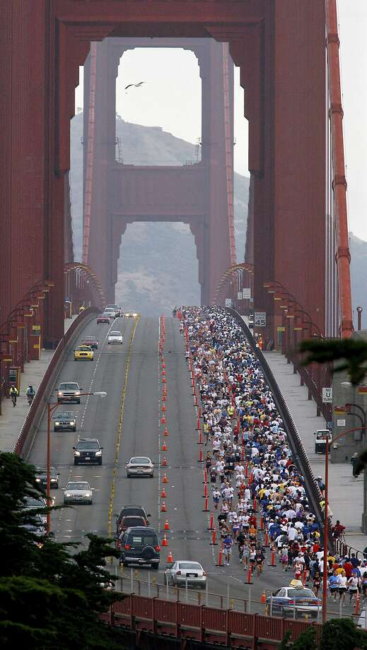FILE - In this July 30, 2006 file photo, San Francisco marathon runners cross the Golden Gate Bridge. For the first time, northbound lanes of the Golden Gate Bridge will be closed during the San Francisco Marathon due to terrorism concerns. Bridge operators decided to keep motorists out of those lanes in this year's marathon between 6 to 9 a.m. Sunday, July 23, 2017, after several terrorist attacks occurred where drivers intentionally plowed into pedestrians. Southbound lanes will be kept open because runners are protected from southbound vehicles by a steel-and-concrete median barrier. (Brant Ward/San Francisco Chronicle via AP, File) Photo: Brant Ward, Associated Press