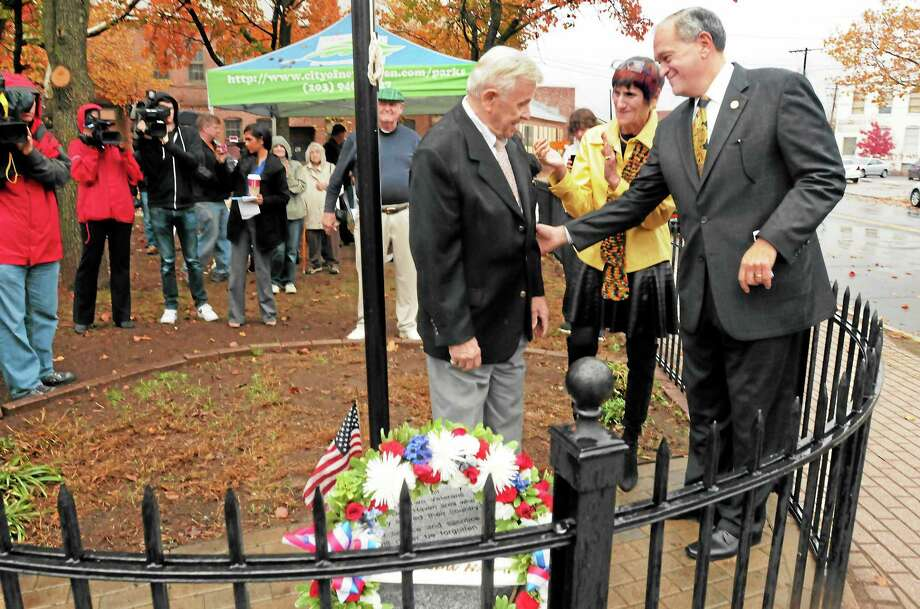 """Veteran Saverio """"Sal"""" Nero of Branford, left, is congratulated by Mayor John DeStefano Jr. and U.S. Rep. Rosa L. DeLauro after laying a wreath at the new World War II memorial at Triangle Park in New Haven Thursday. Nero's brother, Mario, was killed in action in the war. Photo: Mara Lavitt — New Haven Register         / Mara Lavitt"""