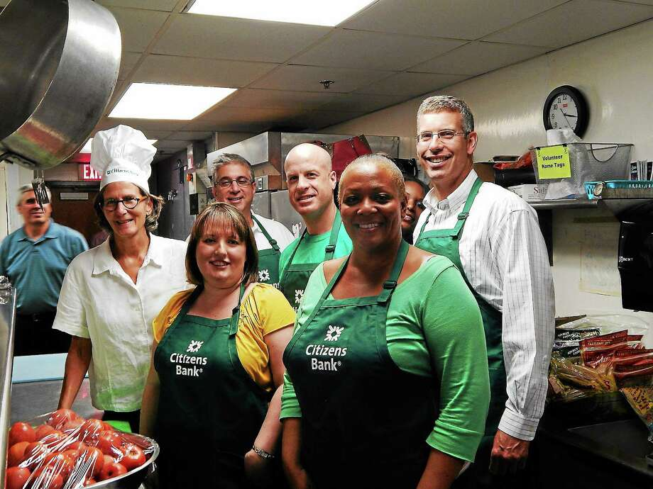 Citizens Bank colleagues recently visited Jennifer Sheldon, Citizens Bank's 2013 Connecticut Community Service Sabbatical recipient, at the Columbus House in New Haven. They prepared food for more than 100 residents. Back: Alison Cunningham, executive director of Columbus House Inc.; Bob Mihalcik; Todd Doherty; and Ned Handy, president, Citizens Bank. Front: Jennifer Sheldon, Citizens Bank's 2013 Connecticut Community Service Sabbatical Recipient, and Jannae Wallace. Photo: Contributed Photo