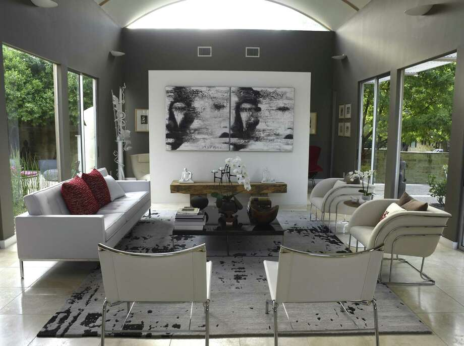 Art by David Harouni graces the living room in this Terrell Hill home. Photo: Billy Calzada /San Antonio Express-News / San Antonio Express-News