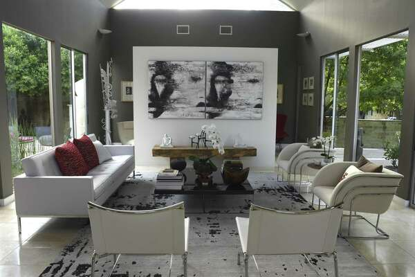 Art by David Harouni, along with a Milo Baughman sofa, grace the living room in this Terrell Hill home.