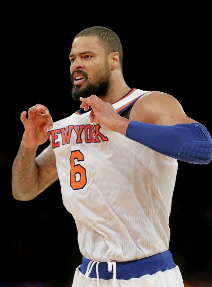 The Knicks' Tyson Chandler tugs at his jersey after a play during the second half of Wednesday's win over the Milwaukee Bucks in New York. Photo: Frank Franklin II — The Associated Press   / AP