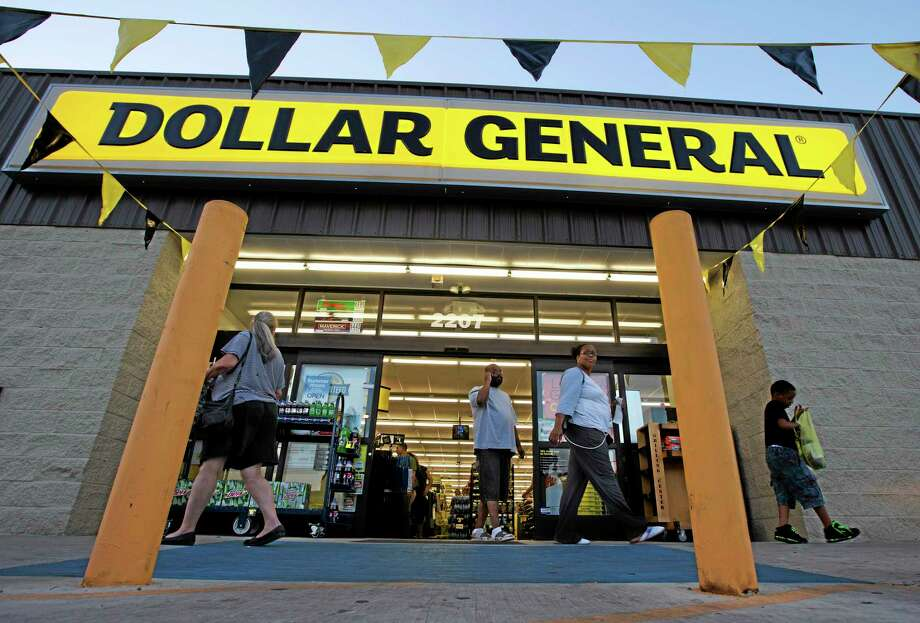 Customers exit a Dollar General store, in San Antonio. Photo: Eric Gay — The Associated Press File Photo   / AP