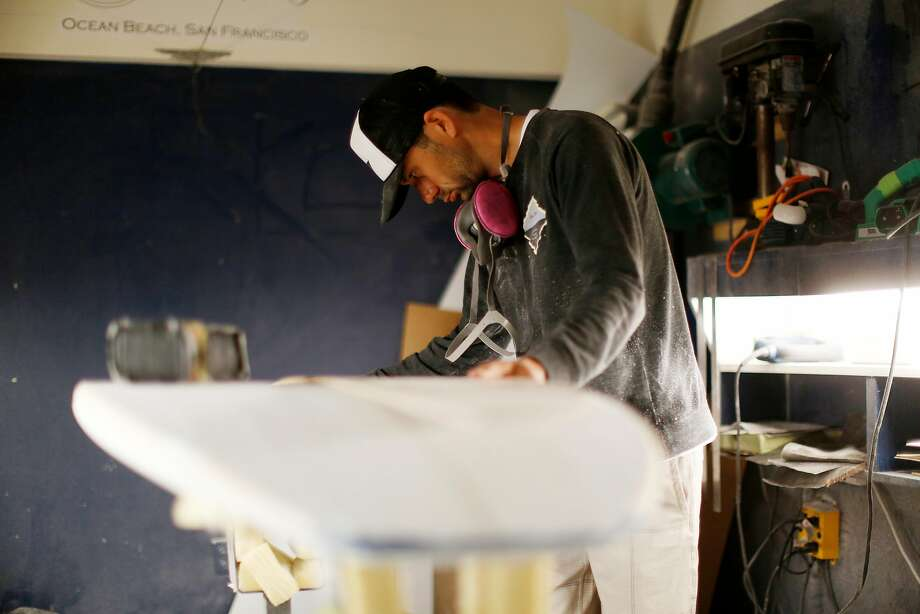 James Mitchell builds   a surfboard, top, and checks the board's tip, above, at his Sunset Shapers shop in the Outer Sunset. Photo: Kathleen Duncan, The Chronicle