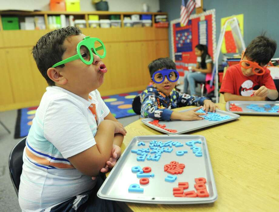 "Giovanni Ayala, 6, sounds out the word ""jug"" before spelling it with magnetic letters during the Horizons at Brunswick Student Enrichment Program at Brunswick School in Greenwich, Conn. Tuesday, July 25, 2017. Horizons at Brunswick is an academic summer camp for low-income Greenwich public school boys who could benefit from supplemental summer learning. Photo: Tyler Sizemore / Hearst Connecticut Media / Greenwich Time"