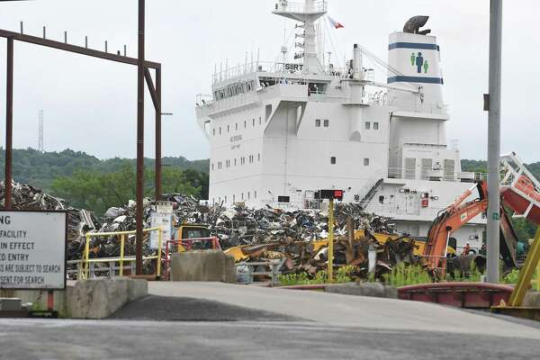 A ship is seen beyond scrap metal at the Sims Metal Management Hudson River Recycling plant on Tuesday, July 25, 2017 in Albany, N.Y.  (Lori Van Buren / Times Union)