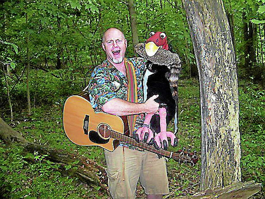 Chris Rowlands uses music, song and puppets to teach kids about the environment. Photo: Contributed