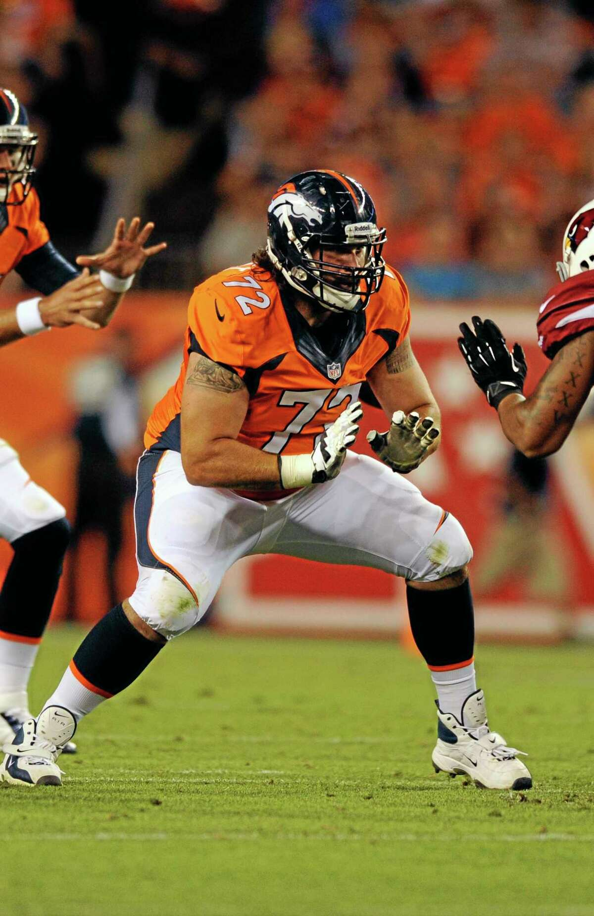 Guilford native and now ex-Broncos guard John Moffitt plays here against the Arizona Cardinals during a preseason game on Aug. 29 in Denver. Moffitt says he quit the NFL this week not because he was unhappy with a lack of playing time in Denver, but because he'd lost his love for the game and was tired of risking his health. The Broncos put him on their reserve/left team list on Tuesday when they activated center J.D. Walton from the physically unable to perform list.