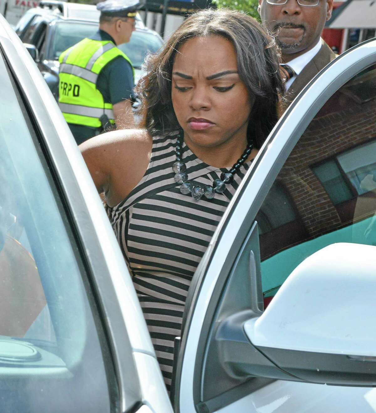Shayanna Jenkins, fiancee of former New England Patriots player and Bristol native Aaron Hernandez, gets into her car outside superior court in this Sept. 6 file photo. She had another scheduled court appearance Wednesday in Fall River Superior Court after being charged with perjury in connection with the murder case against Hernandez.