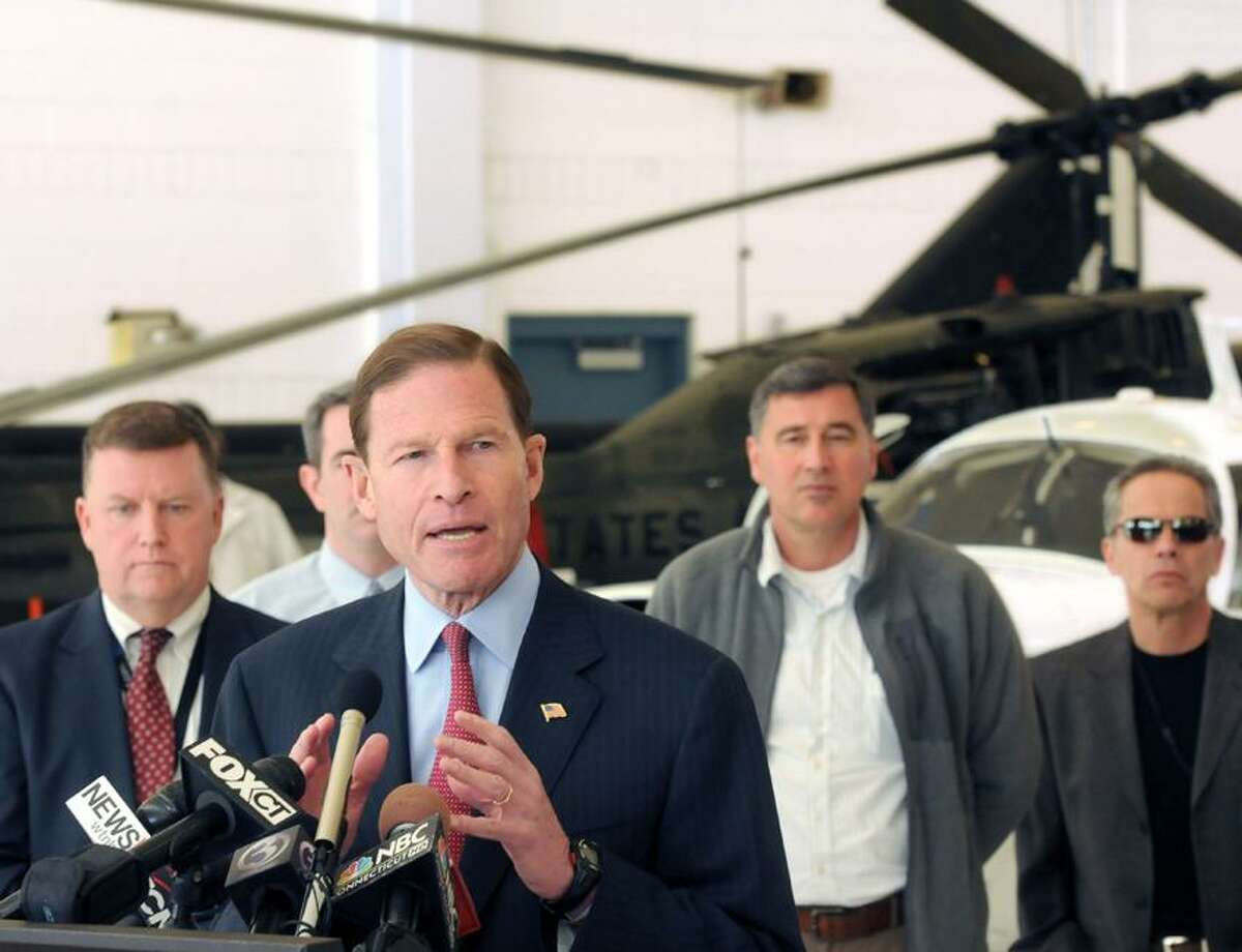 Brainard Airport hangar: US Sen. Richard Blumenthal announced a bi-partisan legislative initiative to save small airports like Tweed-New Haven and Brainard Airport in Hartford from being closed by sequestration. Tweed's executive director Tim Larson is at left. Mara Lavitt/New Haven Register3/18/13