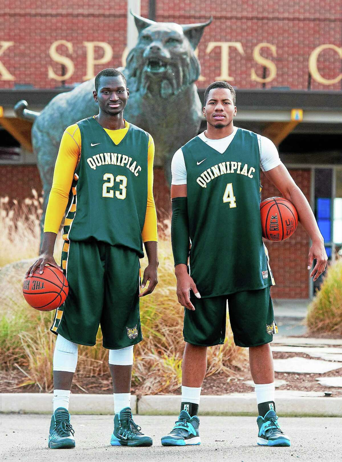 Quinnipiac men's basketball standouts Ousmane Drame (23) and Ike Azotam (4) will lead the Bobcats into their first season as members of the Metro Atlantic Athletic Conference.