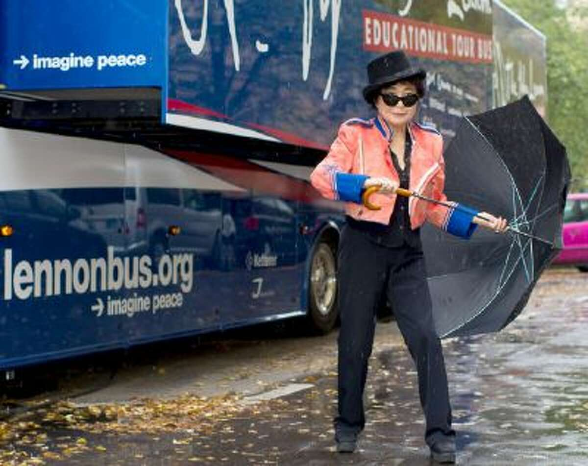 Japanese-US artist Yoko Ono presents the 'John Lennon Educational Tour Bus' in front of John-Lennon-Gymnasium in Berlin, Germany, Tuesday, Oct. 15, 2013. The mobile recording studio offers students the opportunity to record their own piece of music.