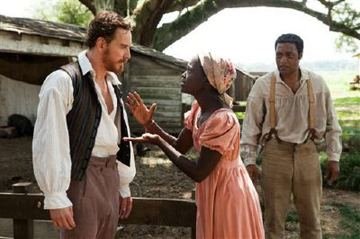 """This image released by Fox Searchlight shows Michael Fassbender, left, Lupita Nyong'o and Chiwetel Ejiofor, right, in a scene from """"12 Years A Slave."""" (AP Photo/Fox Searchlight, Francois Duhamel)"""