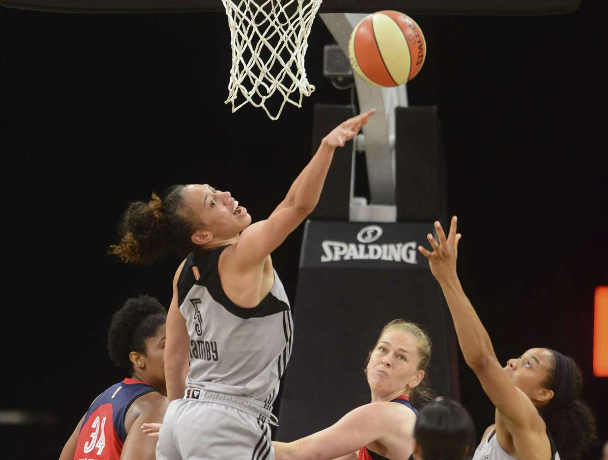 Dearica Hamby of the San Antonio Stars reaches for a rebound against the Washington Mystics during WNBA action in the AT&T Center on Tuesday, July 25, 2017. Washington won, 85-76.